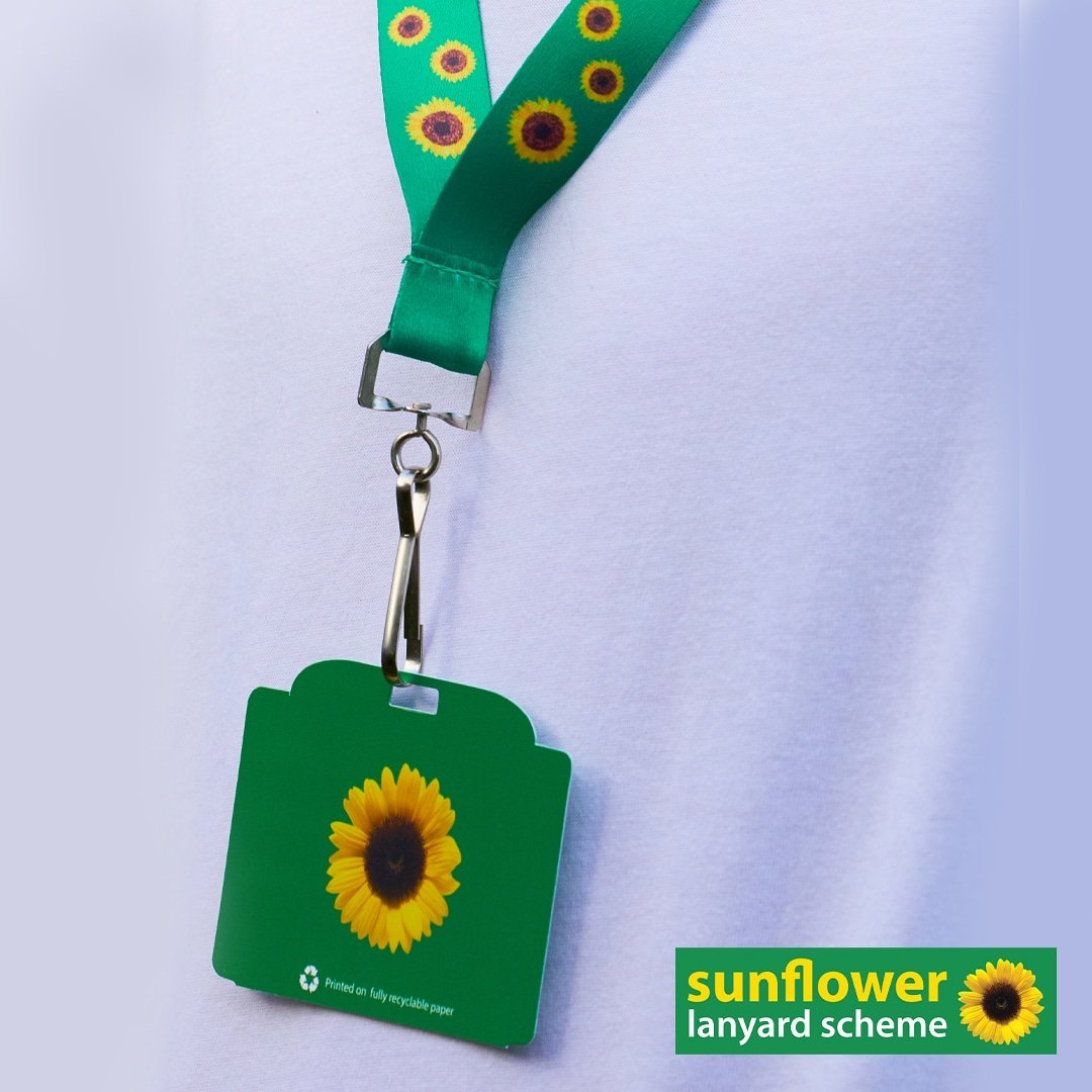 A sunflower lanyard with card attached promoting the sunflower lanyard scheme.