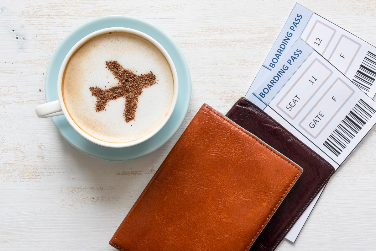 Boarding passes and coffee at the airport